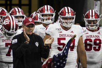 IU football head coach Tom Allen leads players onto the field Aug. 31 at Lucas Oil Stadium in Indianapolis.