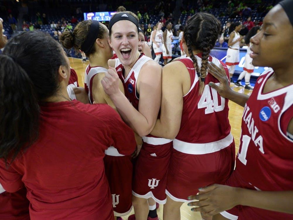 Junior guard Alexis Gassion hugs sophomore forward Amanda Cahill after beating Georgia 62-58 Saturday at Notre Dame. This was IU's first NCAA tournament appearance since 2002. They will play Notre Dame on Monday.