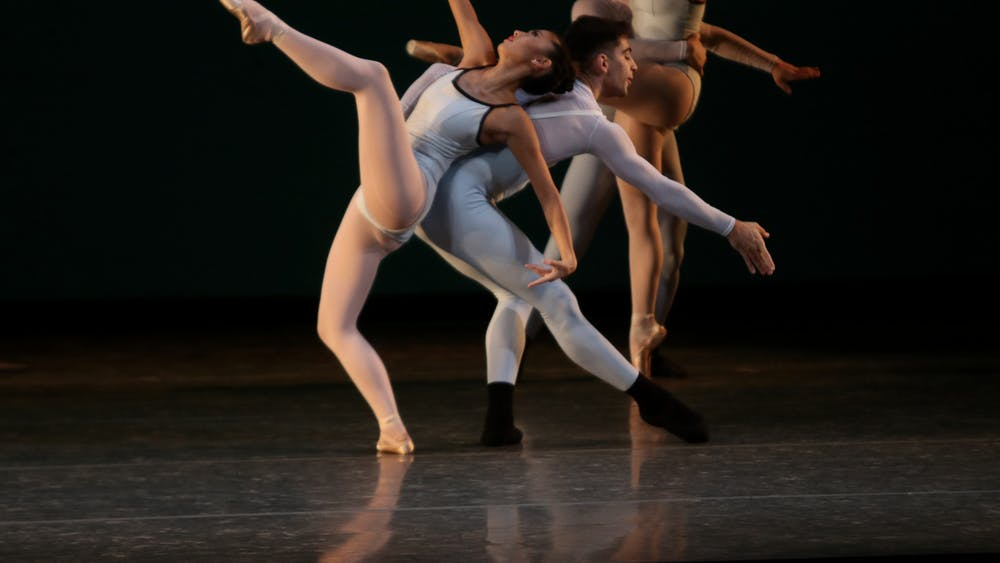 """Two ballet students perform during a rehearsal for """"A Leap Forward"""" Sept. 29, 2021, in the Musical Arts Center. """"A Leap Forward"""" is the school's fall ballet, featuring four different parts."""