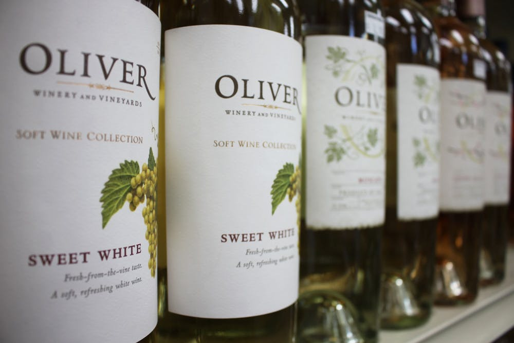 <p>Oliver Winery wine bottles are pictured. Oliver Winery has been purchased by New York private equity firm NexPhase Capital.</p><p><br/></p>