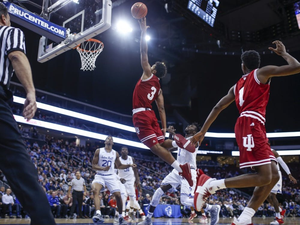 Freshman forward Justin Smith attempts to dunk the ball during the Hoosiers' game against the Seton Hall Pirates on Nov. 15, 2017, at the Prudential Center in Newark, New Jersey. The Hoosiers fell to the Pirates, 84-68.