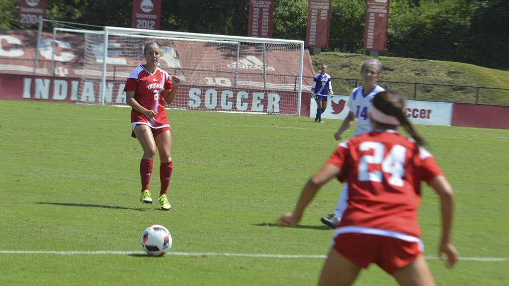 Caroline Dreher kicks the ball to Sydney Kilgore in the Hoosiers' match against Southern Methodist University on Monday at Bill Armstrong Staduim.