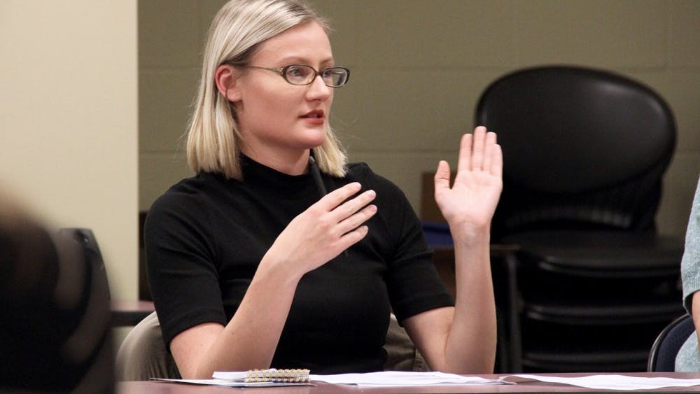 Brittany LaFlower talks about her son's behavior at home during a parent support group Thursday called Tips for Addressing the Behavior Problems of Your Child on the Autism Spectrum.