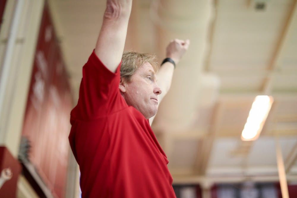 <p>IU swimming head coach Ray Looze raises his arms during the Big Ten Tournament meet Feb. 20, 2019, at Counsilman-Billingsley Aquatic Center in Bloomington. Looze and IU head diving coach Drew Johansen joined Team USA's coaching staff for the 2020 Olympic Games.</p>