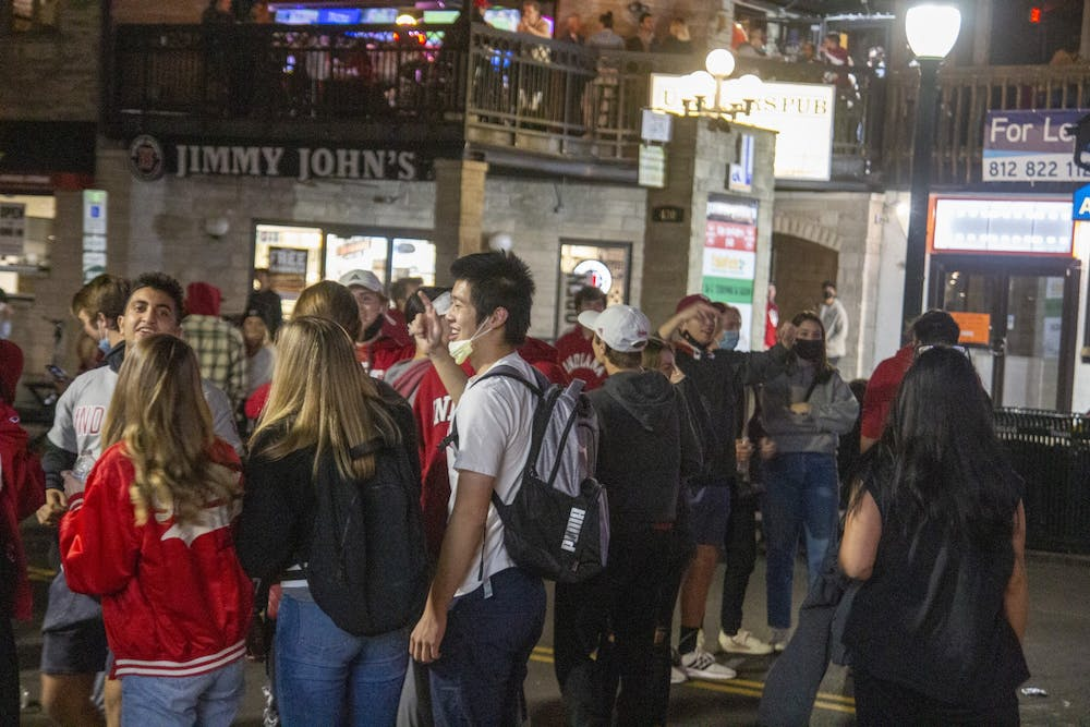 <p>Fans celebrate on Kirkwood Avenue after IU defeated No. 8 Penn State on Saturday. The victory was IU's first win over a top-10 opponent since 1987.</p>