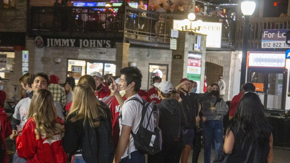 Fans celebrate on Kirkwood Avenue after IU defeated No. 8 Penn State on Saturday. The victory was IU's first win over a top-10 opponent since 1987.