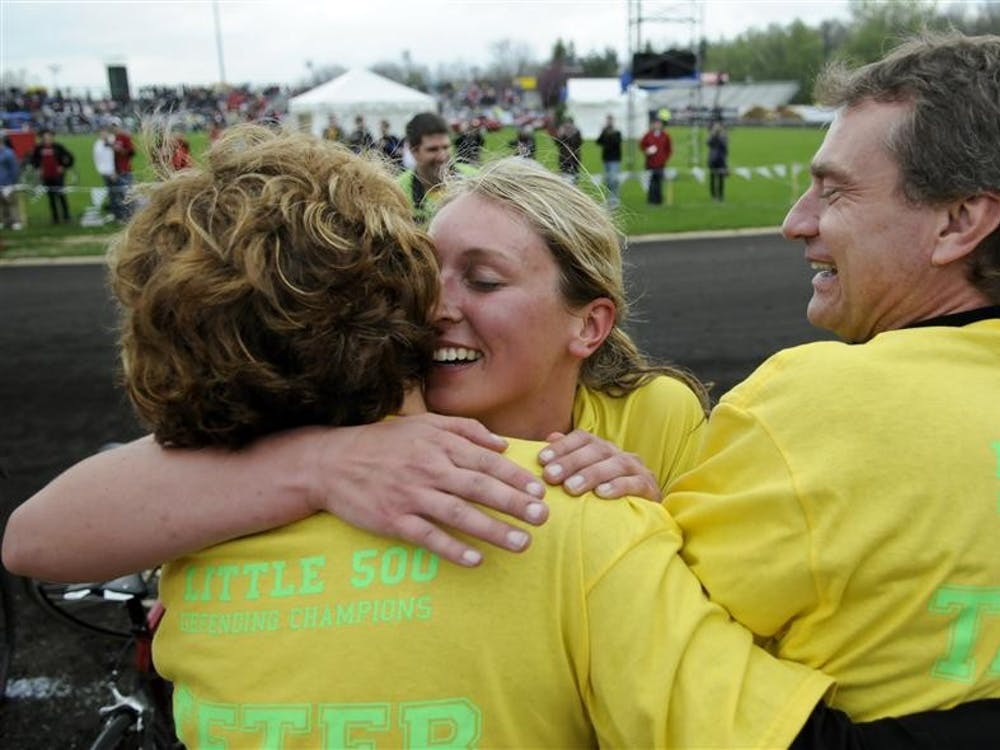 Teter senior Caitlin Van Kooten hugs her parents, Mary and Rick, after winning the women's Little 500 on April 15, 2011, at Bill Armstrong Stadium. Van Kooten's team won the race for the second year in a row.