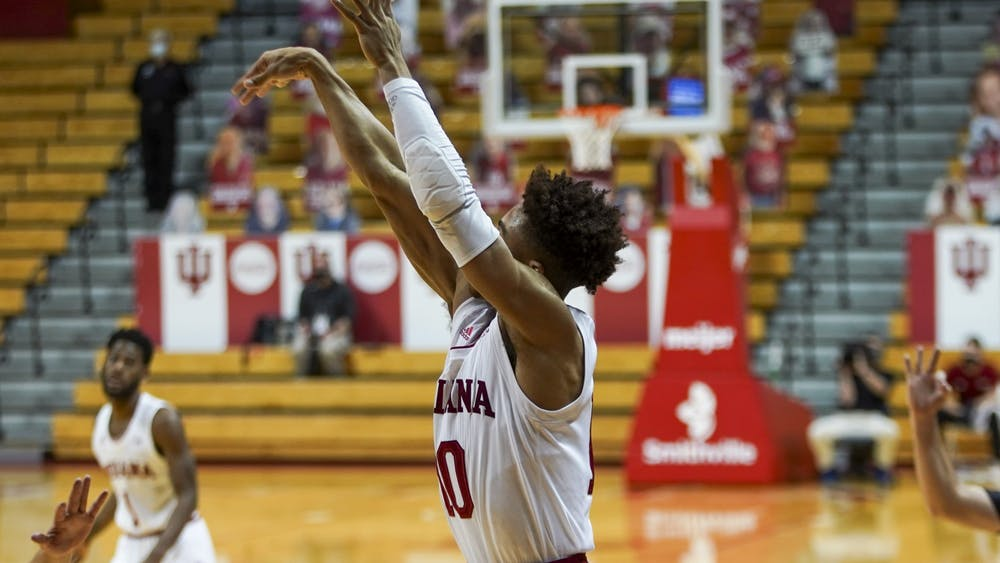 Junior guard Rob Phinisee scores a 3-point shot Dec. 13 at Simon Skjodt Assembly Hall. Phinisee scored eight of IU's 87 points in the victory over the University of North Alabama.