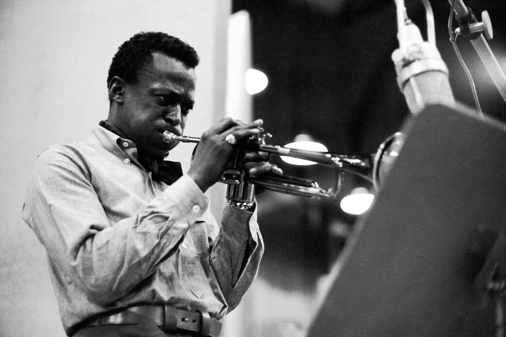 <p>Jazz musician Miles Davis plays the trumpet in 1959. Many Black musicians have faced consequences of copyright laws and claims that pieces of music have been stolen without credit. </p>