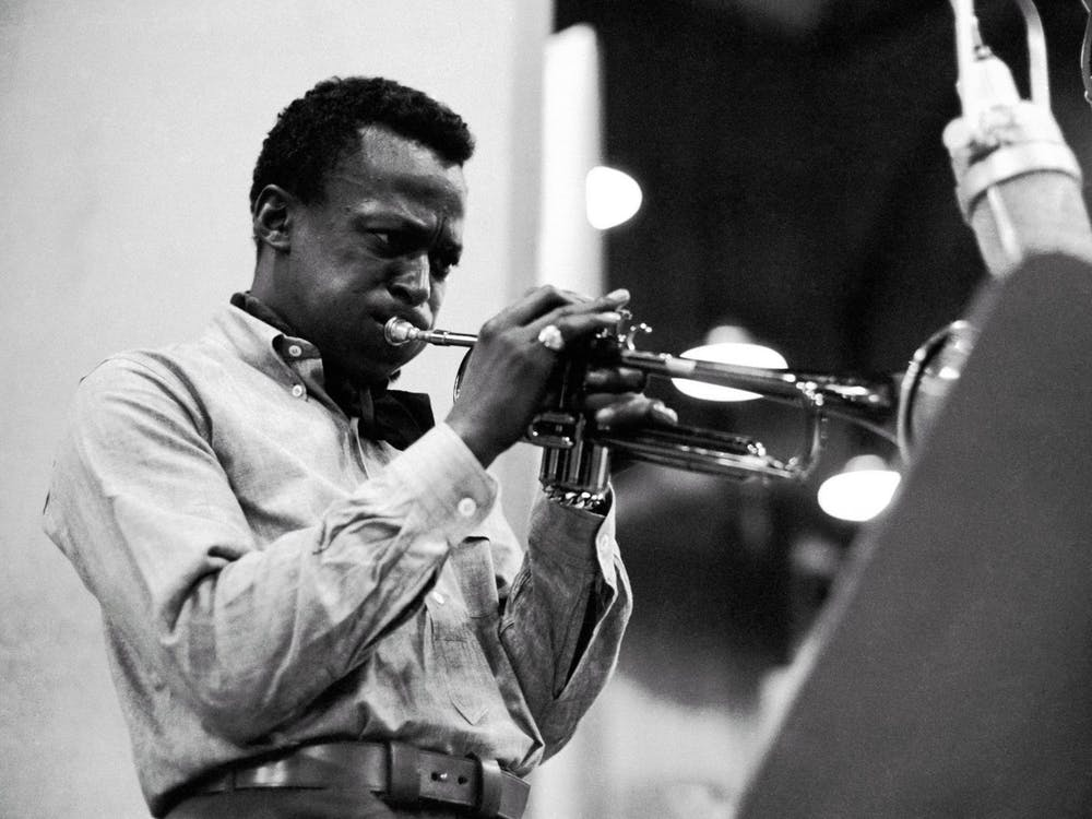 Jazz musician Miles Davis plays the trumpet in 1959. Many Black musicians have faced consequences of copyright laws and claims that pieces of music have been stolen without credit.