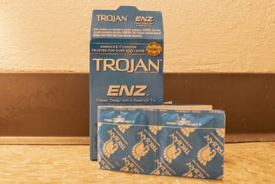 A box of Trojan condoms sits May 14 on the ground.