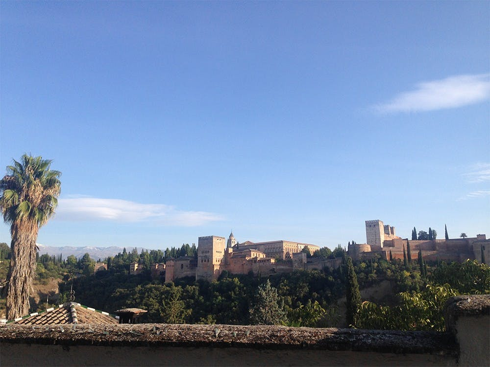 A view of the famous Alhambra in Granada, Spain. Columnist Lauren Saxe recommends spending time and money on experiences while studying abroad, not material things.