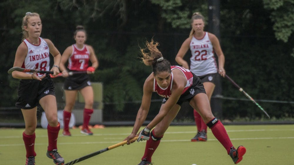 Junior Andi Jackson swings at the ball during the Cream & Crimson scrimmage on Aug. 17. The team will play a nonconference match against Miami University on Sunday.