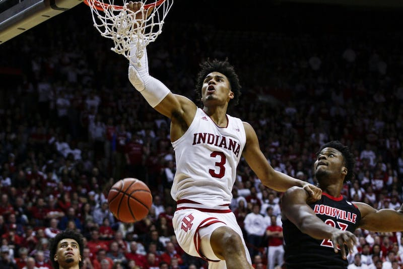 Freshman forward Justin Smith dunks the ball Dec. 8 at Simon Skjodt Assembly Hall against University of Louisville. IU defeated Louisville, 68-67.