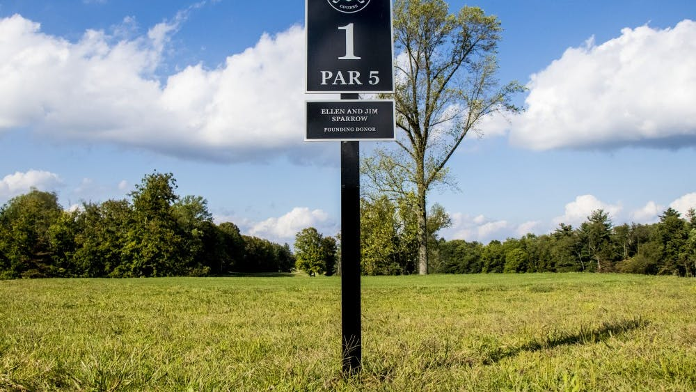The first hole sign is seen at the Pfau Indiana University Golf Course.