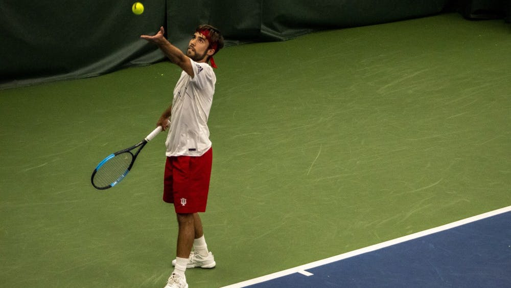 Senior Antonio Cembellin serves during his final match in Bloomington on April 14 at the IU Tennis Center. IU will play Penn State on Friday in University Park, Pennsylvania.