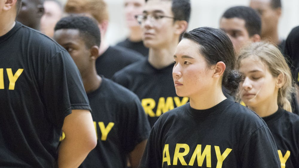 Jihea Song, an Emory University student, does physical training at Georgia Institute of Technology with ROTC students from Emory, Georgia Tech and Agnes Scott College three mornings a week. Military recruiters target working class students on campus, writes columnist Serena Fox.