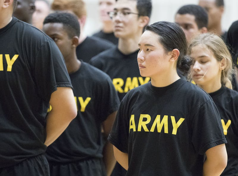 Jihea Song, an Emory University student, does physical training at Georgia Institute of Technology with ROTC students from Emory, Georgia Tech and Agnes Scott College three mornings a week. Military recruiters target working class students on campus writes columnist Serena Fox.