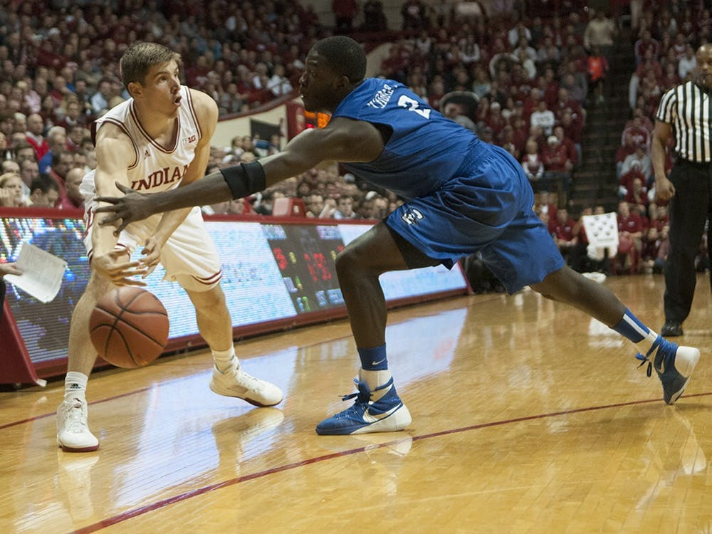 Junior forward Collin Hartman passes the ball during the game against Creighton on Thursday at Assembly Hall.