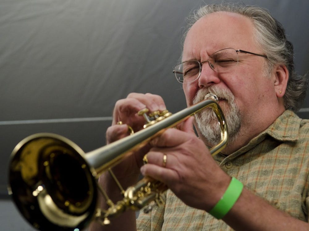 Trumpet player Pat Harbison performs in an ensemble of Jacobs School of Music faculty during the Grant Street Jazz Festival on Saturday on Grant Street just south of Sixth Street.