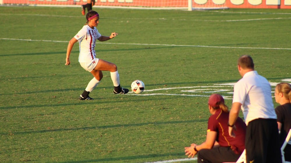 Defender Julia Gulliam kicks ball to the goal  during Friday's match up against Minnestoa.