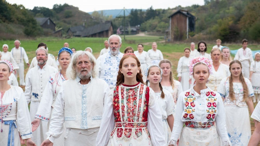"""""""Midsommar""""was released June 3. The film is about a young couple, played by Florence Pugh and Jack Reynor, who to travel to Sweden to visit their friend's rural hometown and participate in a ritual at the hands of a pagan cult."""