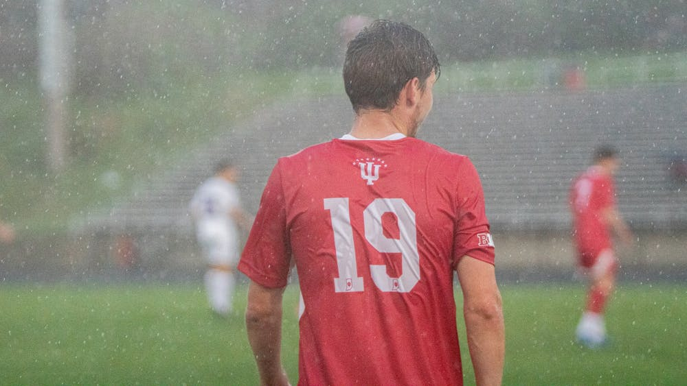 The rain pours down on Sophomore Defender Brett Bebej on April 10 at Bill Armstrong Stadium. IU men's soccer fell to Marshall University 1-0 Monday in overtime of the NCAA Championship.