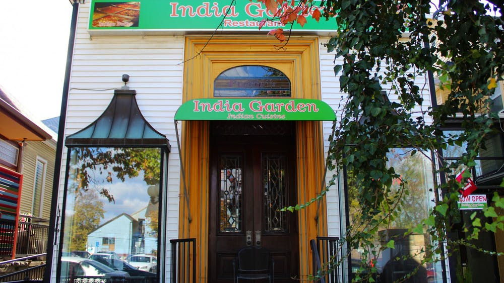 India Garden Restaurant sits behind a tree Nov. 5 on Fourth Street. India Garden is one of multiple restaurants on Fourth Street offering international fare.