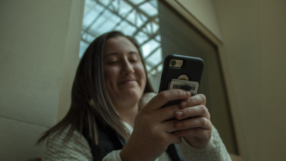A student looks at her phone March 4 in Franklin Hall.