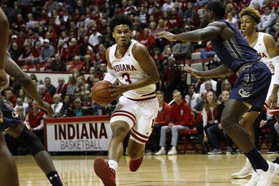 Sophomore forward Justin Smith runs the ball up the court against Montana State on Nov. 9 in Simon Skjodt Assembly Hall. Smith scored 13 out of the 80 points. IU won against Montana State, 80-35.