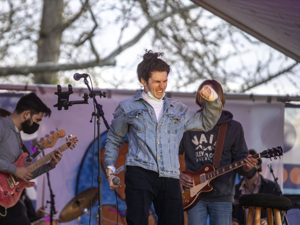 """Micah Bachrach preforms his original song """"Darlin'"""" during the BDMC Presents concert Thursday in Dunn Meadow. The song was released on streaming platforms in March."""