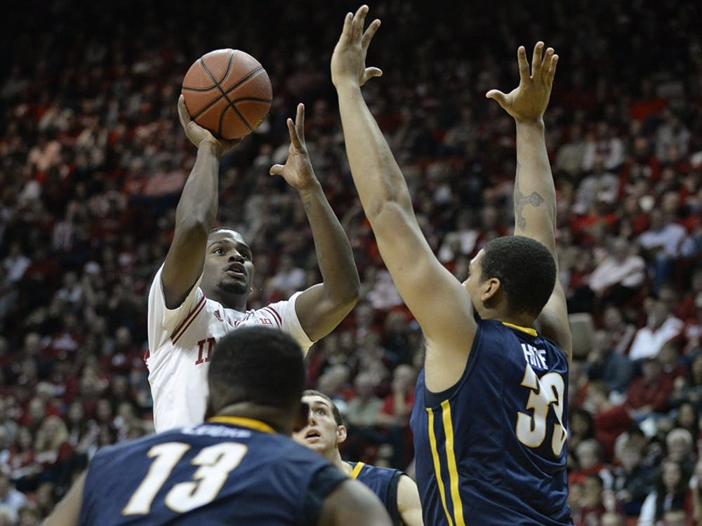 Sophomore guard Stan Robinson goes for two during IU's game against North Carolina-Greensboro on Friday at Assembly Hall.