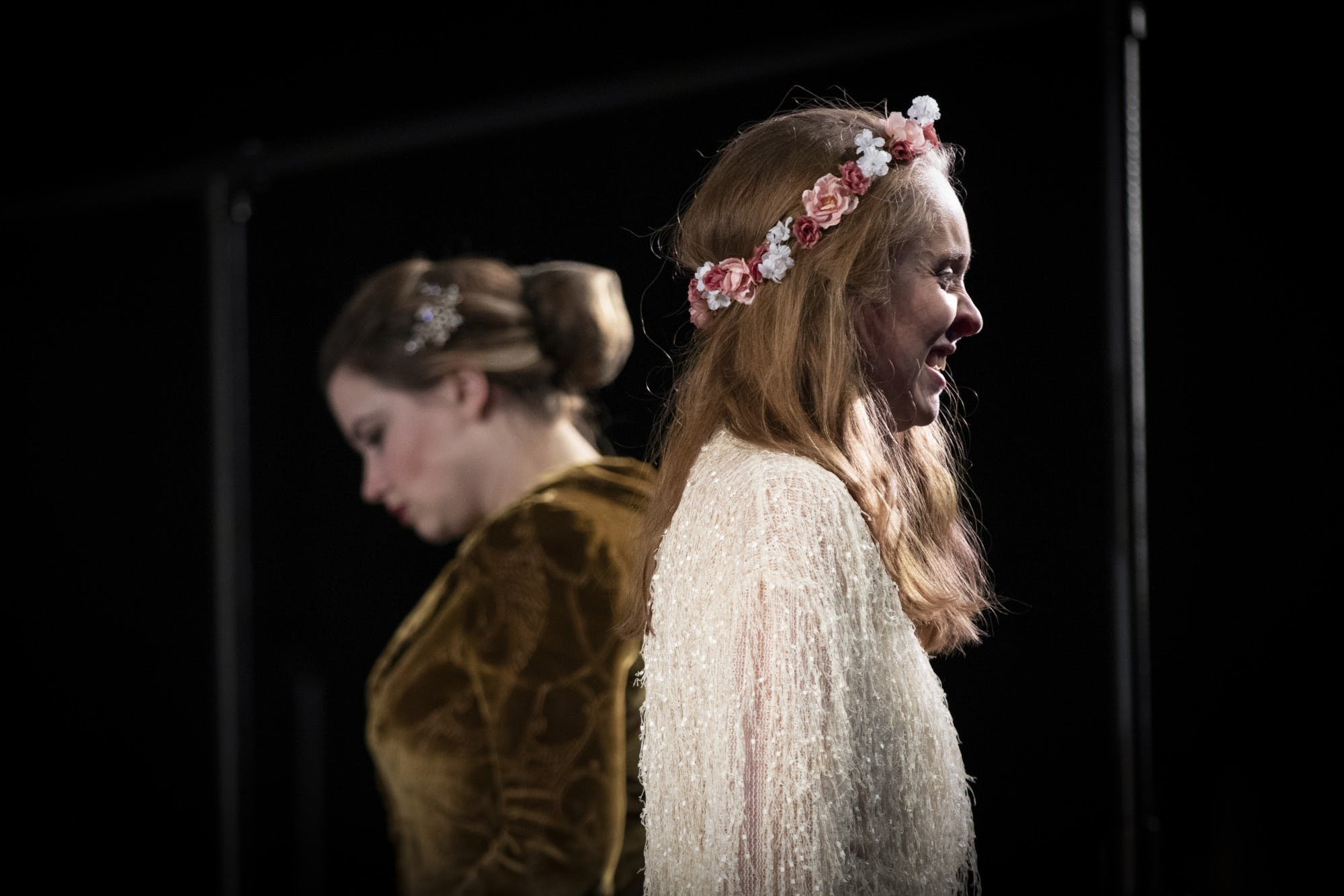 Actress Isabelle Gardo, left, bows her head during a tense scene with actress Anna Doyle on Dec. 3 in Ruth N. Halls Theatre. During the 1600s, it was common for men to play all the roles in performances, even those even those that were originally cast for females.