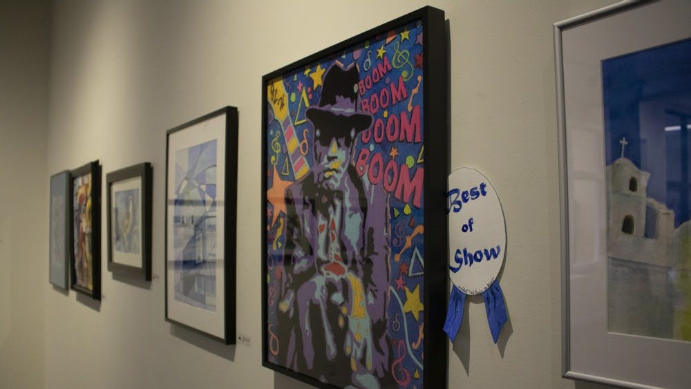 "Art exhibit ""We Paint… the Blues"" showcases local art from Feb. 1 to March 29 at The Vault at Gallery Mortgage in downtown Bloomington. All of the artwork follows the theme of ""blues,"" so every piece reflects this by either its color, emotion or definition."