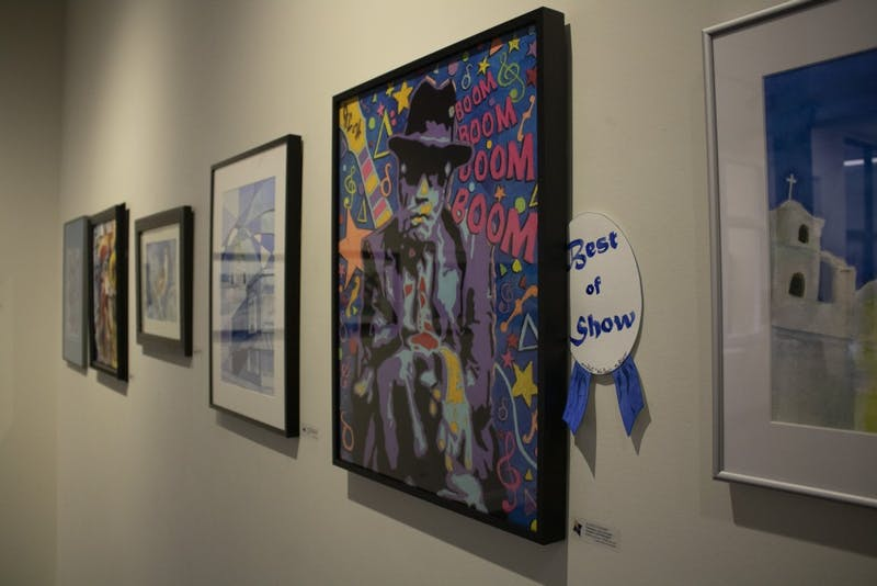 """Art exhibit """"We Paint… the Blues"""" showcases local art from Feb. 1 to March 29 at The Vault at Gallery Mortgage in downtown Bloomington. All of the artwork follows the theme of """"blues,"""" so every piece reflects this by either its color, emotion or definition."""