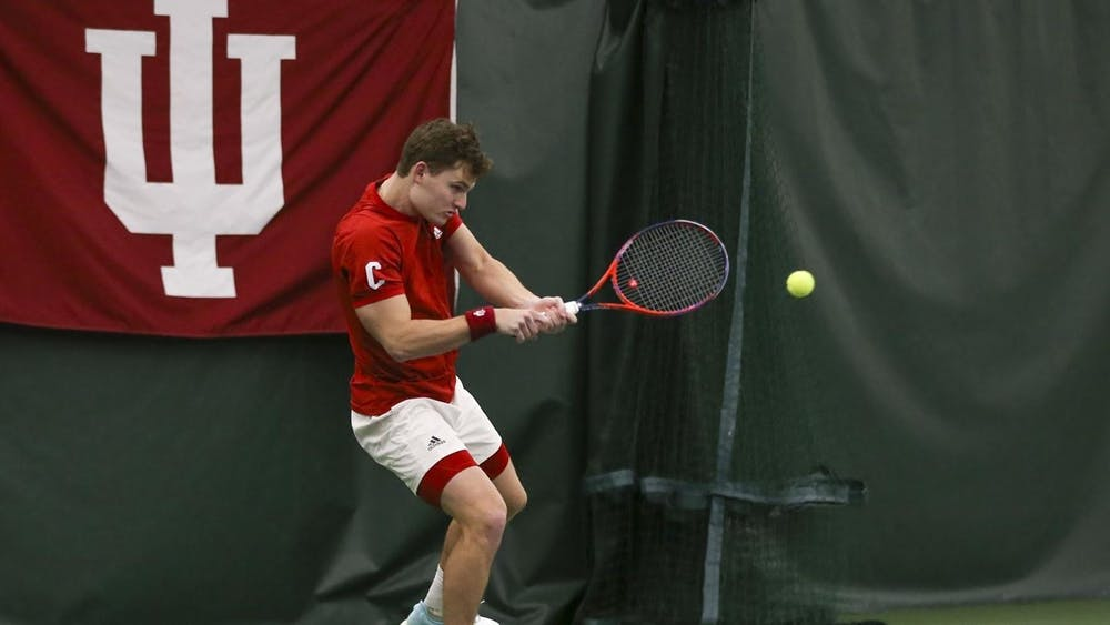 Senior Andrew Redding swings the racket March 13 at the IU Tennis Center. IU lost 0-4 to Northwestern on Sunday.