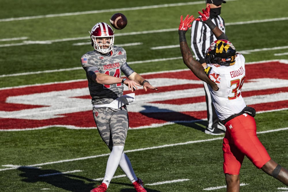 Redshirt sophomore quarterback Jack Tuttle throws the ball in the third quarter Nov. 28 at Memorial Stadium. Tuttle went into the game after redshirt sophomore quarterback Michael Penix Jr. was injured in the third quarter.
