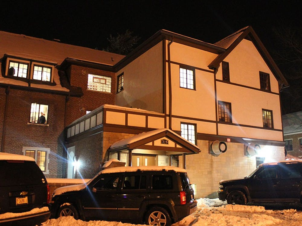 The Alpha Tau Omega house on Third Street is well lit during a Saturday night party in February. A pledge was stationed at the back door, signing girls into the party.