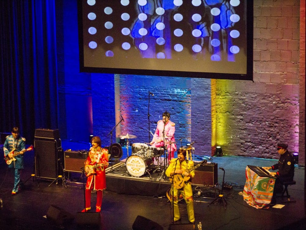 """The Mersey Beatles play their set Friday night at the Buskirk-Chumley Theater, which was packed for the tribute band's third performance in Bloomington. The Mersey Beatles performed """"Sgt. Pepper's Lonely Hearts Club Band,"""" which celebrated its 50th anniversary this year."""