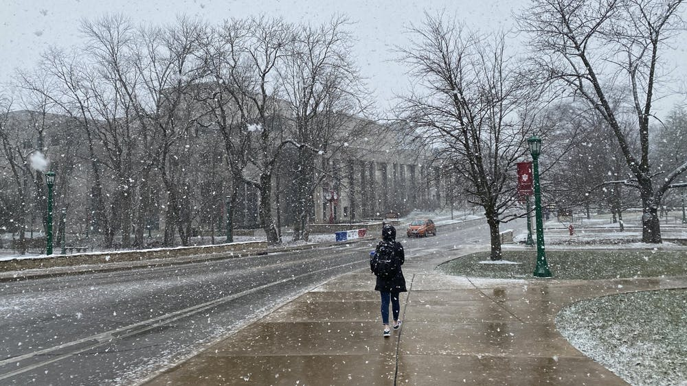 An IU student walks through the snow Feb. 9, 2020, on Jordan Avenue.