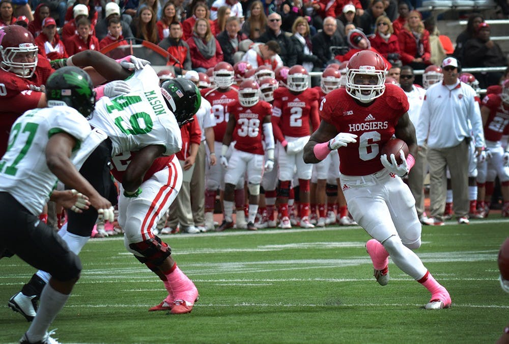Junior running back Tevin Coleman runs with the ball during IU's game against North Texas on Saturday at Memorial Stadium.