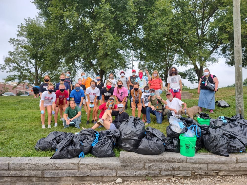 The Bloomington Homeless Coalition, with members of the IU Field Hockey and Soccer teams, gather Sept. 12 for its weekly community clean-up.