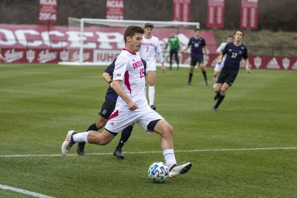 <p>Then-sophomore Brett Bebej passes the ball March 23 in Bill Armstrong Stadium. IU is scheduled to play eight conference games in the fall 2021 schedule</p>