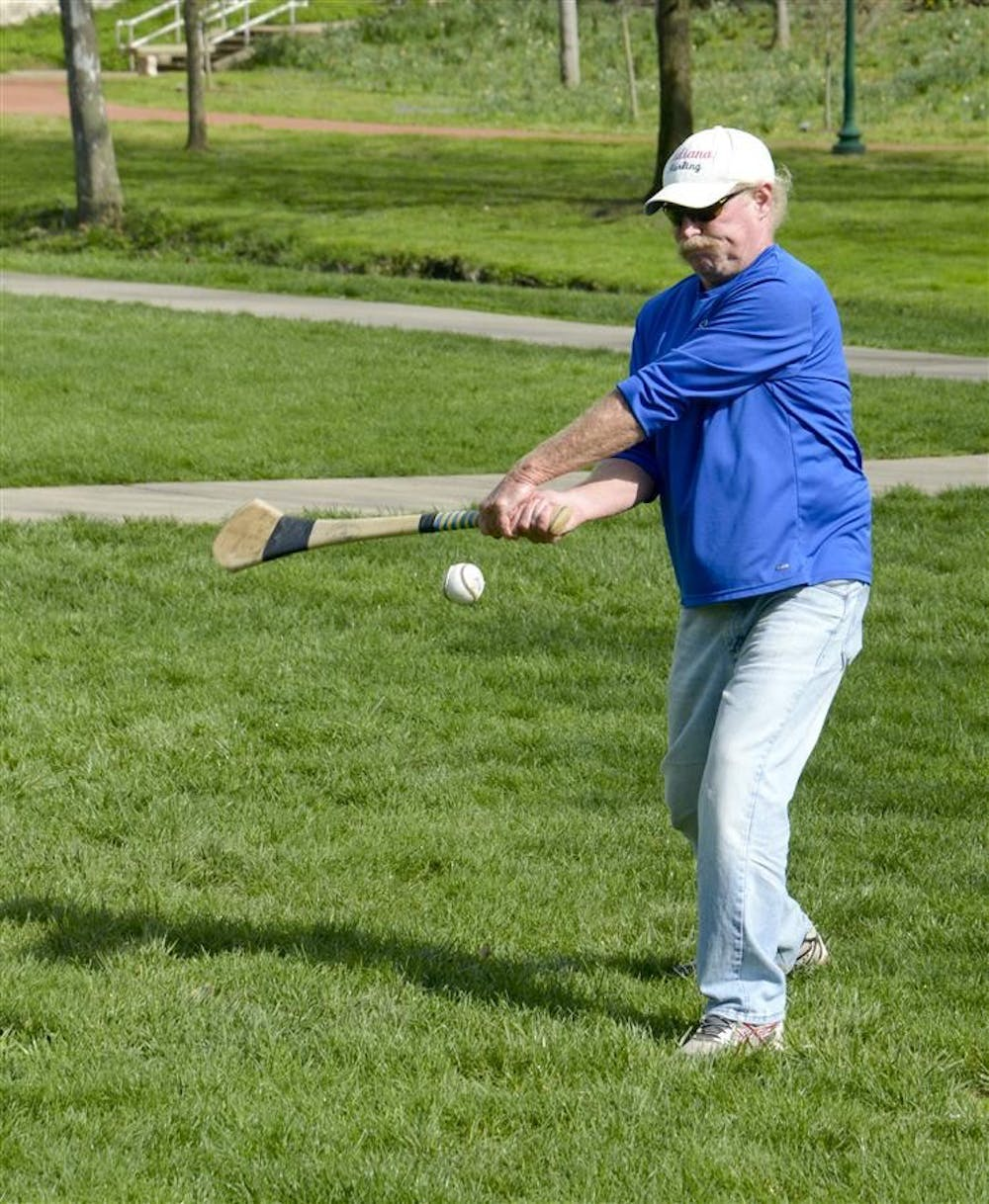 Coach Tom Fick practices hurling Wednesday afternoon in Dunn Meadow. Fick is the coach of the IU Hurling Club who competes around the region.