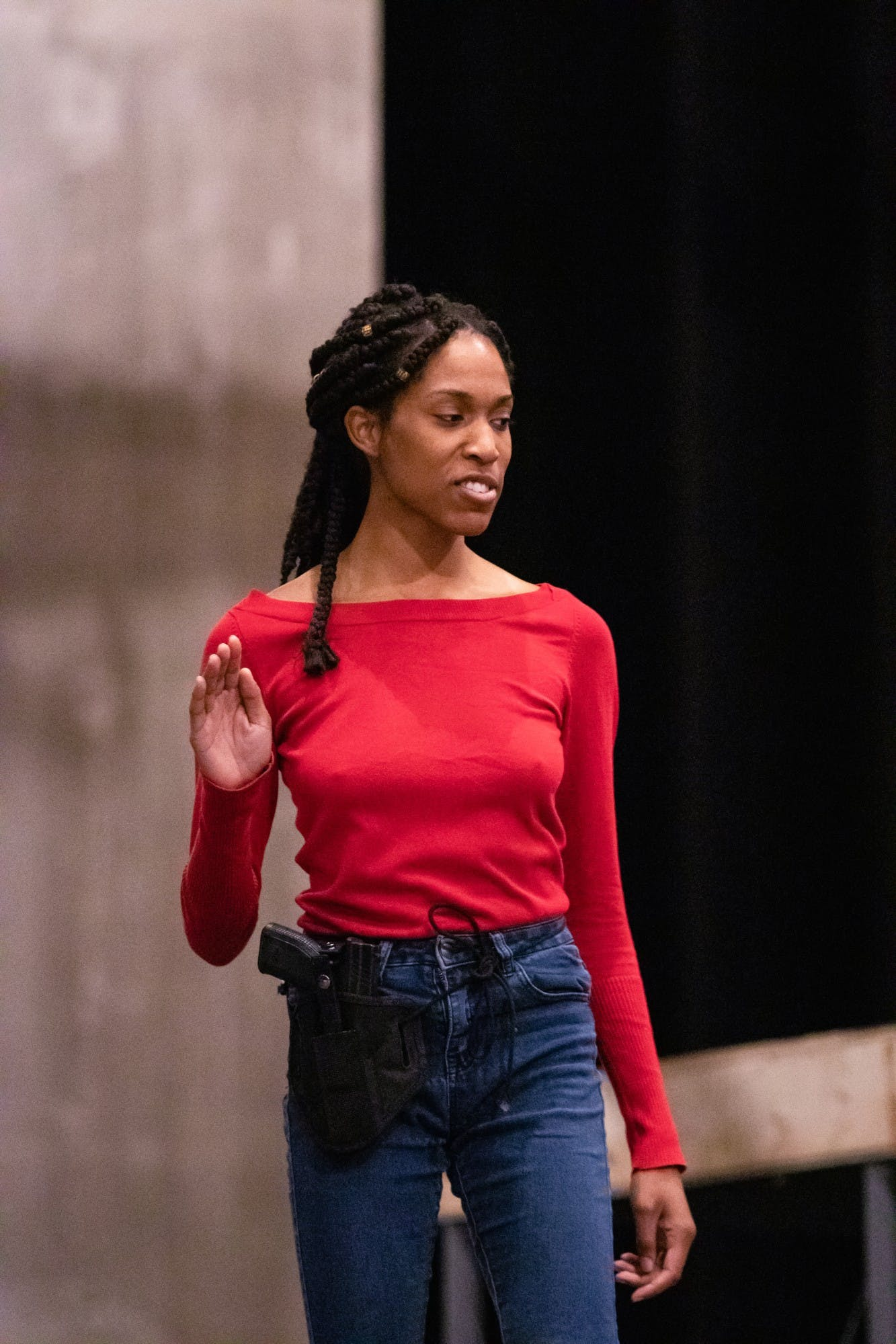 """Actress Adrianne Embry runs through her final lines as Fortinbras Nov. 13 on stage in Ruth N. Halls Theatre. Embry was shocked when director Jonathan Michaelsen chose her to play Fortinbras in his production of """"Hamlet."""""""