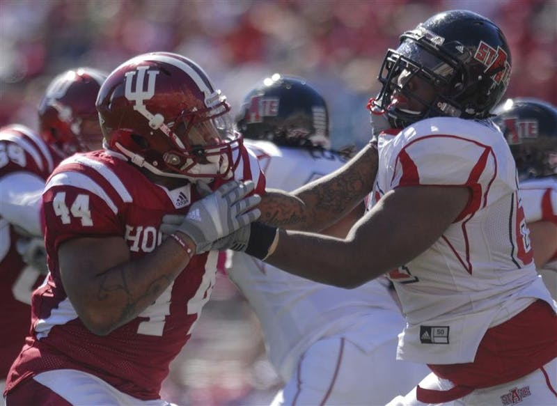 Former defensive end Darius Johnson tries to get past an Arkansas State University offensive lineman Oct. 18, 2010, at Memorial Stadium. The game against Arkansas State was the last homecoming football game the Hoosiers have won.
