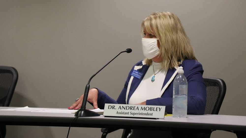 Assistant Superintendent Dr. Andrea Mobley speaks during the Monroe County Community School District Board of Trustees meeting Sept. 28, 2021, in the MCCSC Co-Lab building. The board approved an amendement allowing staff and students that have been exposed to an asymptomatic person to return to school after testing negative for COVID-19.