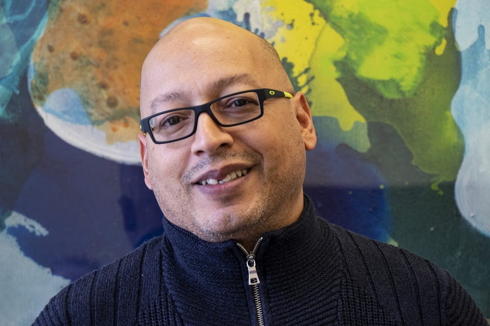 <p>Bruce Smail is pictured Feb. 26 in a conference room in Bryan Hall. Smail is the interim director of the IU LGBTQ+ Culture Center and Special Assistant to the Vice President of Diversity, Equity, and Multicultural Affairs.</p>