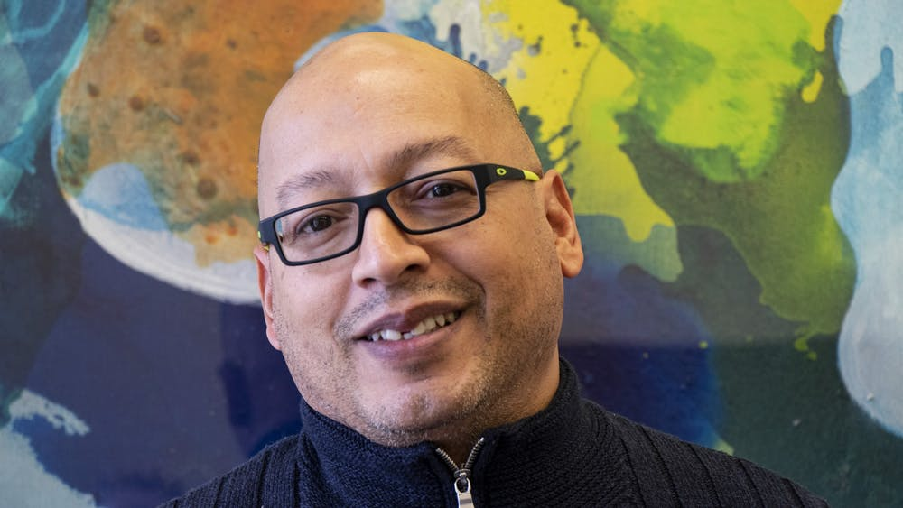 Bruce Smail is pictured Feb. 26 in a conference room in Bryan Hall. Smail is the interim director of the IU LGBTQ+ Culture Center and Special Assistant to the Vice President of Diversity, Equity, and Multicultural Affairs.
