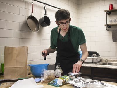 Joe Banchik, 25, is on the autism spectrum. Banchik tests recipes such as a recipe for paleo-friendly granola as seen in the photo for required internship experience at the College Internship Program in Bloomington.